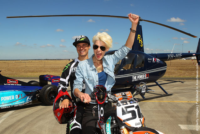 Australian Motorcross rider and member of the Crusty Demons, Robbie Marshall and 2012 Formula 1 Australian Grand Prix Ambassador Kate Peck pose after Marshall jumped over a helicopter with rotating blades and a Formula 1 car at Avalon Airport