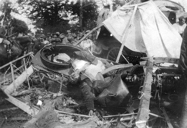 A German pilot lies dead in his crashed airplane in France, in 1918. (Photo by National World War I Museum, Kansas City, Missouri, USA via The Atlantic)