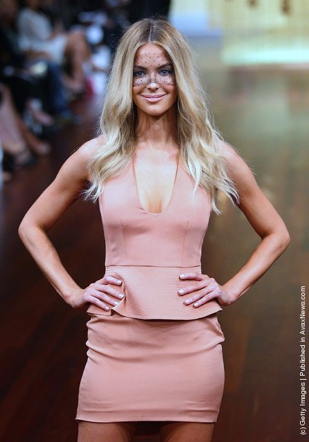 Model Jennifer Hawkins showcases designs by Yeojin Bae on the catwalk at the Myer A/W 2012 Collection Launch