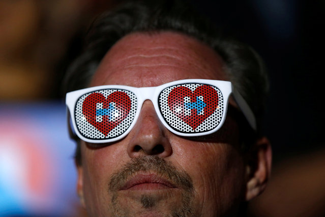 A supporter wears a sunglasses adorned with logos of Democratic U.S. presidential candidate Hillary Clinton during a campaign event in San Francisco, California, U.S. May 26, 2016. (Photo by Stephen Lam/Reuters)