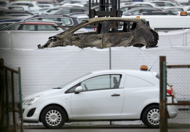 A burned-out car is removed from the site of the airplane crash at the British Car Auctions lot next to Blackbushe Airport, near Camberley in southern Britain August 1, 2015. A private jet crashed in southern England on Friday, killing four people on board, a spokesman for Britain's Hampshire police service said, and Saudi and British media said the passengers were relatives of deceased al Qaeda leader Osama Bin Laden. (Photo by Luke MacGregor/Reuters)