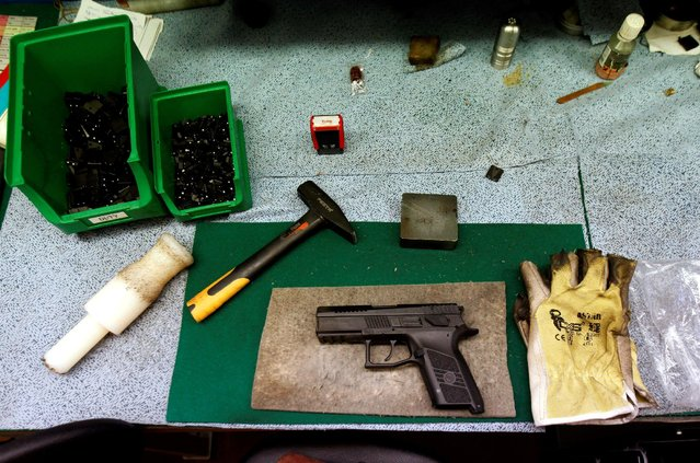 A newly assembled pistol is placed on a workbench in Ceska Zbrojovka weapons factory in Uhersky Brod, Czech Republic, May 27, 2016. (Photo by David W. Cerny/Reuters)