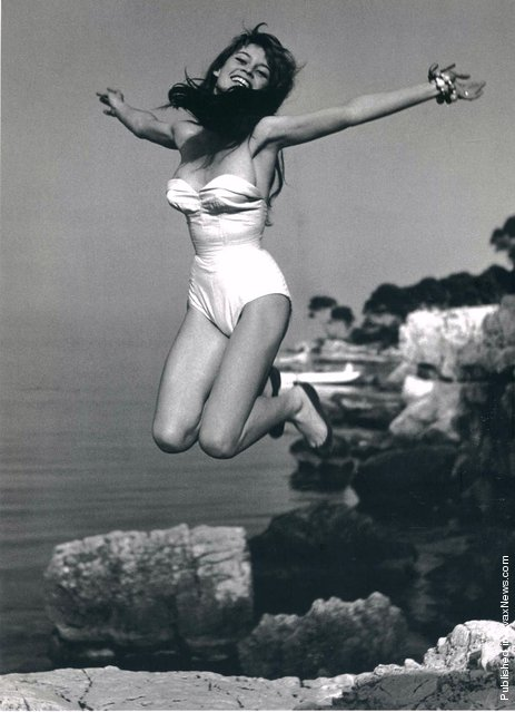 Former French fashion model, actress, singer and animal rights activist Brigitte Bardot jumping in front of her villa, La Madrague, France, 1955. (Photo by Philippe Halsman)