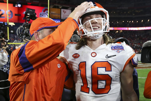 Clemson quarterback Trevor Lawrence (16) is congratulated after Clemson defeated Ohio State 29-23 in the Fiesta Bowl NCAA college football playoff semifinal Saturday, December 28, 2019, in Glendale, Ariz. (Photo by Ross D. Franklin/AP Photo)