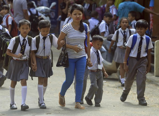 Indian children leave after attending school in Dimapur, in India's north-eastern state of Nagaland, Tuesday, August 4, 2015. (Photo by Sorei Mahong/AP Photo)