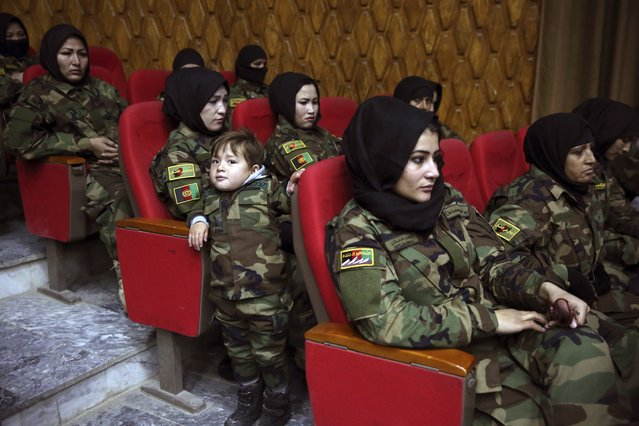 Newly graduated Afghan female National Army soldiers attend their graduation ceremony after a three month training program at the Afghan Military Academy in Kabul, Afghanistan, Sunday, January 5, 2020. (Photo by Rahmat Gul/AP Photo)