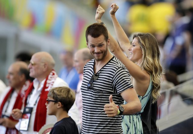 Tom Brady, right, and Gisele Bundchen arrive to attend the World Cup final soccer match between Germany and Argentina at the Maracana Stadium in Rio de Janeiro, Brazil, Sunday, July 13, 2014. (Photo by Hassan Ammar/AP Photo)