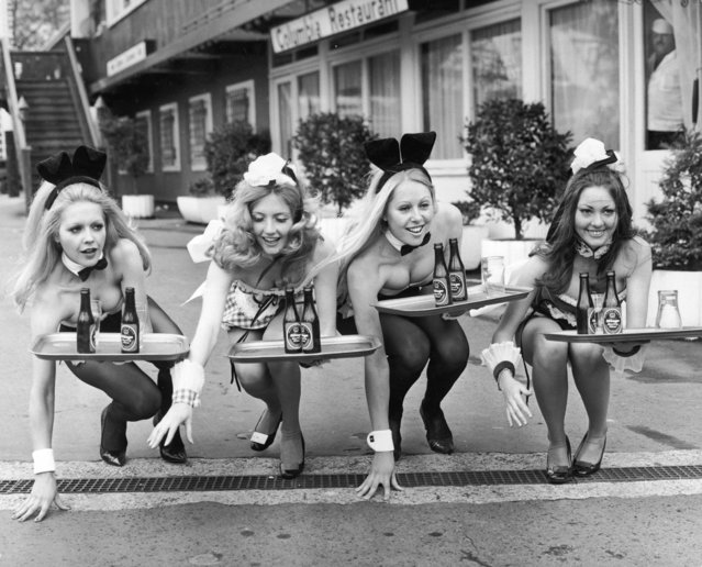 Two Bunny Girls from the Playboy Club and two Penthouse Pets from the Penthouse Club prepare to take part in the annual Good Friday waiters and waitresses race in Battersea Festival Gardens, London, 28th March 1972. (Photo by Ian Showell/Keystone/Hulton Archive/Getty Images)