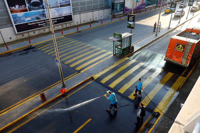 Workers wash the road at Turkey's largest airport, Istanbul Ataturk, following yesterday's blast June 29, 2016. (Photo by Osman Orsal/Reuters)