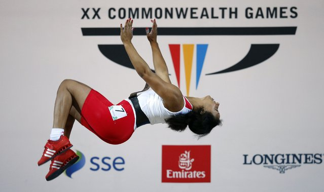 Zoe Smith of England celebrates after winning the gold medal in the women's 58kg weightlifting competition at the 2014 Commonwealth Games in Glasgow, Scotland, July 26, 2014. (Photo by Phil Noble/Reuters)