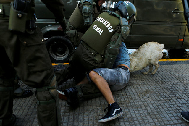 A demonstrator is detained during an unauthorized march called by the Chilean student federations to protest against government's education reform, in Santiago, Chile July 5, 2016. (Photo by Ivan Alvarado/Reuters)