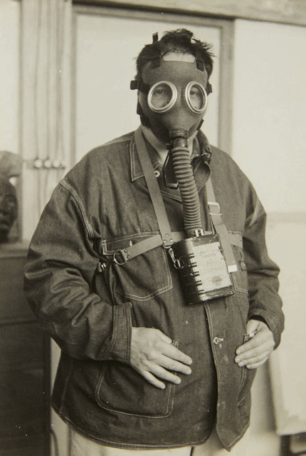 In this 1938 photo provided by Sotheby's, painter Diego Rivera poses with a gas mask in Casa Azul, Mexico. The image is part of a collection of photographs by Nicholas Muray up for auction on Friday, April 5, 2019. (Photo by Nickolas Muray via Sothebys via AP Photo)