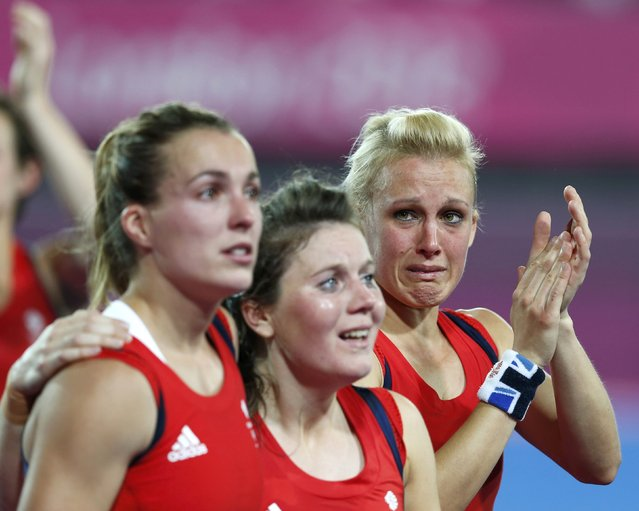 Great Britain's players react after defeated by Argetina at their women's semifinal hockey match at the Riverbank Arena at the London 2012 Olympic Games August 8, 2012. (Photo by Suzanne Plunkett/Reuters)
