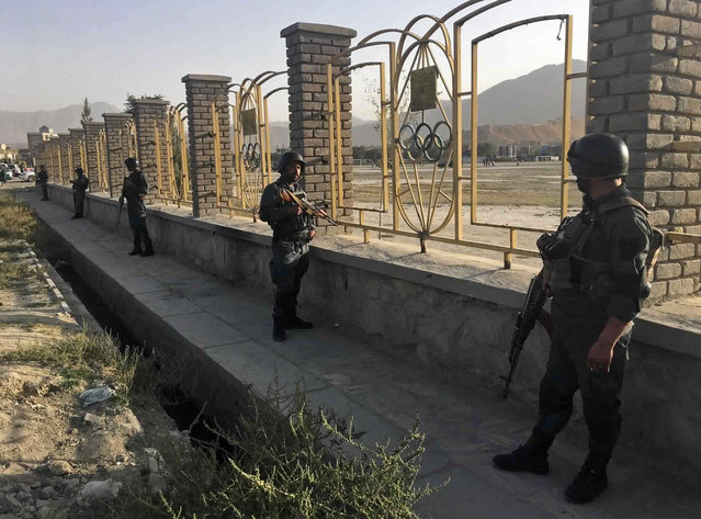 Afghan security police stand guard near the site of a deadly suicide attack outside a cricket stadium, in Kabul, Afghanistan, Wednesday, September 13, 2017. (Photo by Rahmat Gul/AP Photo)