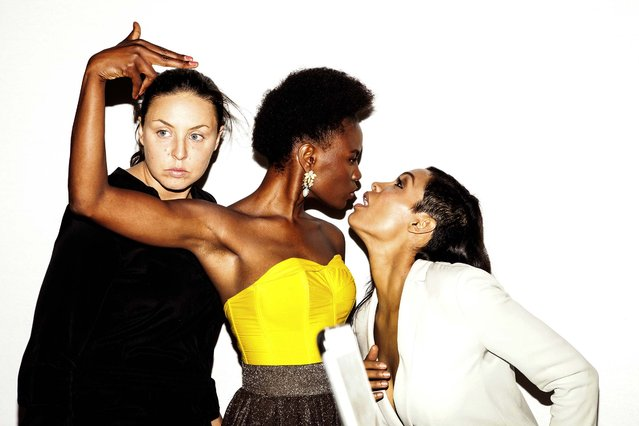 From left: Ann Kleinhenz, Shingai Shoniwa, and Rosario Dawson pose in a photo booth at a party thrown by Calvin Klein during New York Fashion Week, September 8, 2014. (Photo by Amy Lombard/The New York Times)