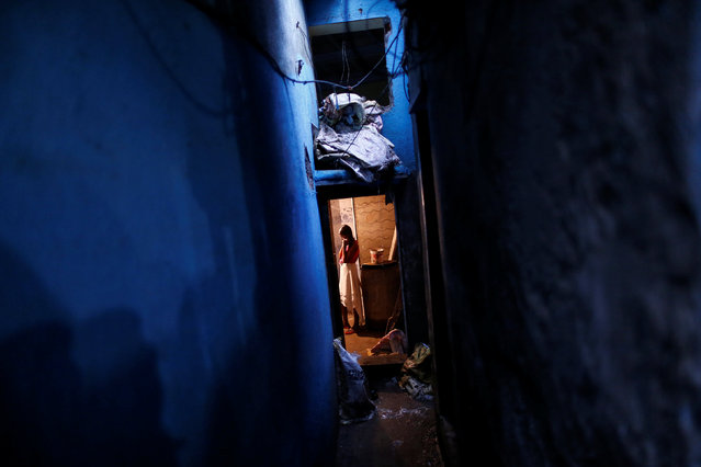 A girl stands inside her under construction shanty at a slum in Mumbai, India, August 3, 2016. (Photo by Danish Siddiqui/Reuters)