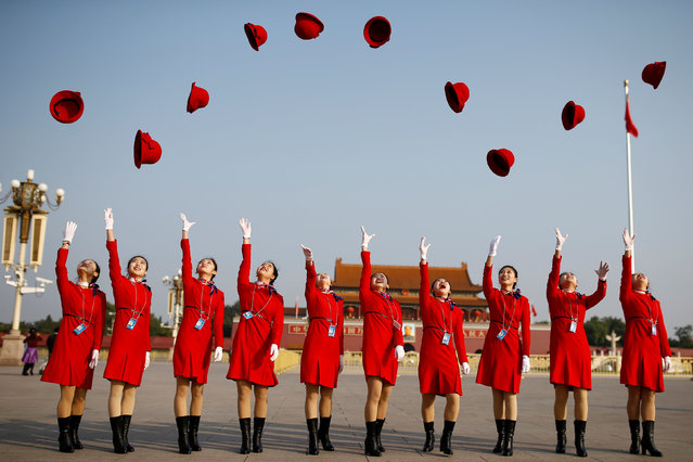 Ushers throw their hats in the air in Tiananmen Square before the closing ceremony of China's 19th Party Congress at the Great Hall of the People in Beijing, Tuesday, October 24, 2017. (Photo by Thomas Peter/Reuters)