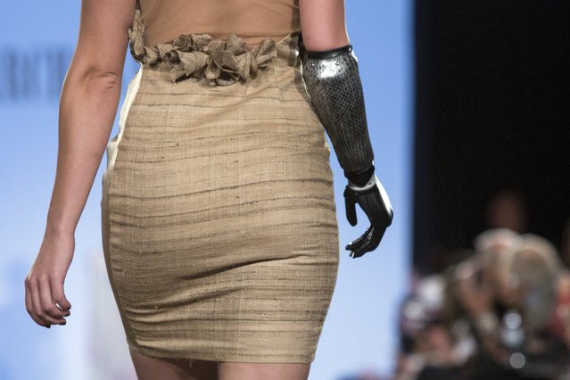 Rebekah Marine, a model with a bionic arm, presents a creation from Archana Korchhar during the FTL Moda presentation of the Spring/Summer 2016 collection during New York Fashion Week in Vanderbilt Hall at Grand Central Station, New York, September 13, 2015. (Photo by Andrew Kelly/Reuters)
