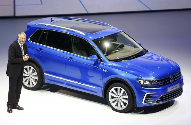 Member of the Board of Management for the Volkswagen brand Heinz-Jakob Neusser presents the VW Tiguan GTE during the Volkswagen group night ahead of the Frankfurt Motor Show (IAA) in Frankfurt, Germany, September 14, 2015. (Photo by Kai Pfaffenbach/Reuters)