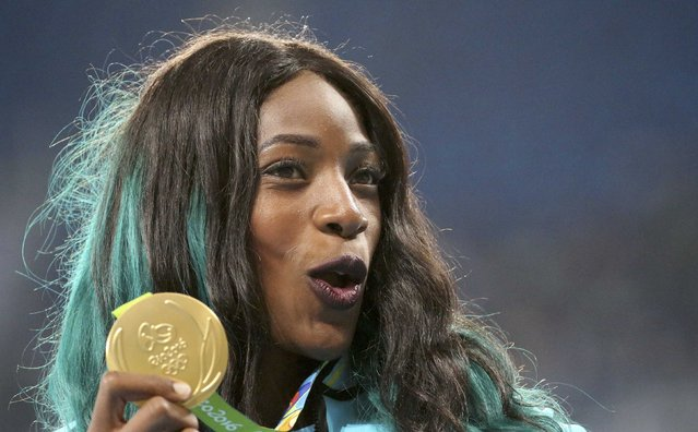 2016 Rio Olympics, Athletics, Victory Ceremony, Women's 400m Victory Ceremony, Olympic Stadium, Rio de Janeiro, Brazil on August 16, 2016. Gold medalist Shaunae Miller (BAH) of Bahamas reacts. (Photo by Sergio Moraes/Reuters)