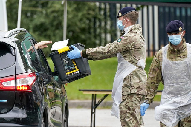 Soldiers from the Royal Logistics Corp operate a mobile coronavirus (Covid-19) testing site at Evington Leisure Centre on June 29, 2020 in Leicester, England. In a television appearance on Sunday, British Home Secretary Priti Patel confirmed the government was considering a local lockdown after a spike in coronavirus cases in the city. The city's mayor has said that Pubs and restaurants in Leicester may stay closed for two more weeks due to a recent surge in coronavirus cases. (Photo by Christopher Furlong/Getty Images)