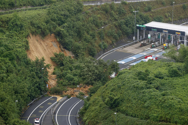 A landslide is seen near an exit of a highway in Kyoto, western Japan Thursday, July 9, 2020. Pounding rain spread to central Japan and triggered mudslides. (Photo by Kyodo News via AP Photo)