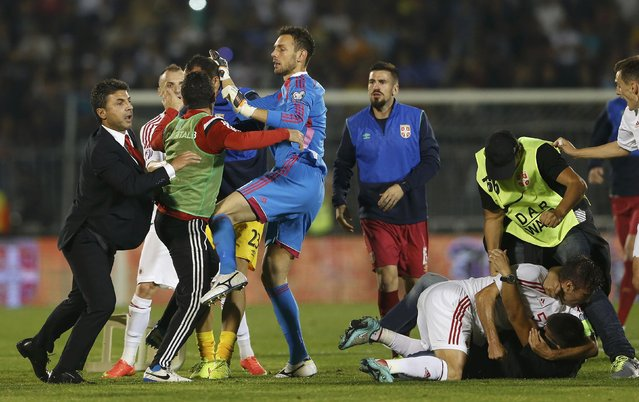 Fans and players of Serbia and Albania scuffle during their Euro 2016 Group I qualifying soccer match at the FK Partizan stadium in Belgrade October 14, 2014. (Photo by Marko Djurica/Reuters)