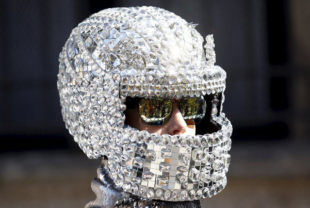 A person wears an helmet as advertising creation during the Spring/Summer 2016 collections at the Milan Fashion Week in Italy, September 26, 2015. (Photo by Stefano Rellandini/Reuters)