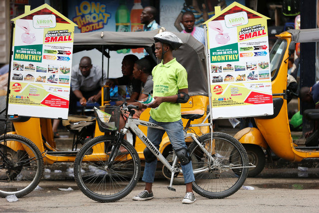 A man advertises property during a street marketing campaign in Ikeja district in Nigeria's commercial capital Lagos September 2, 2016. (Photo by Akintunde Akinleye/Reuters)