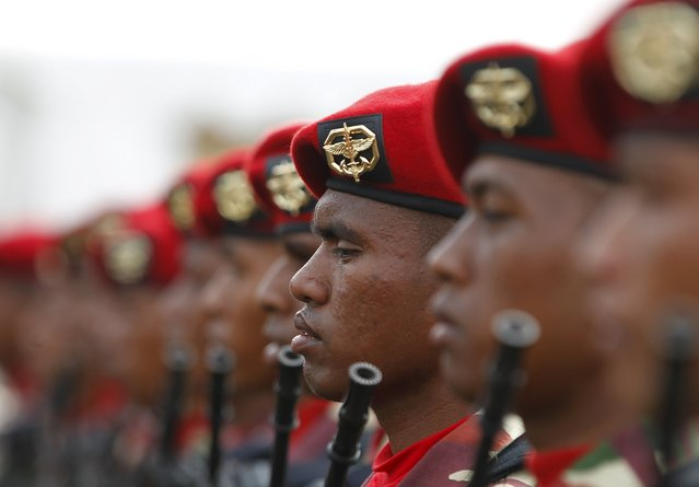 Members of the Kopassus, an Indonesian special forces group, hold rifles as they stand at attention during a rehearsal for a ceremony marking the 70th anniversary of Indonesia's military in Cilegon, Banten province, October 3, 2015. (Photo by Reuters/Beawiharta)