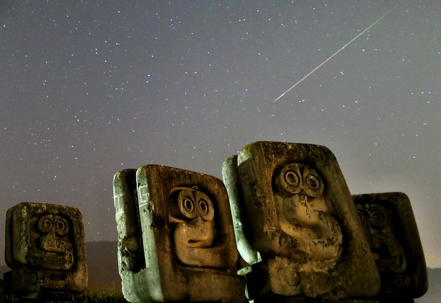 A meteor streaks past stars in the night sky above the Necropolis on Smrike for the victims of Fascism during the Perseid meteor shower in Novi Travnik, Bosnia and Herzegovina, August 12, 2020. (Photo by Dado Ruvic/Reuters)