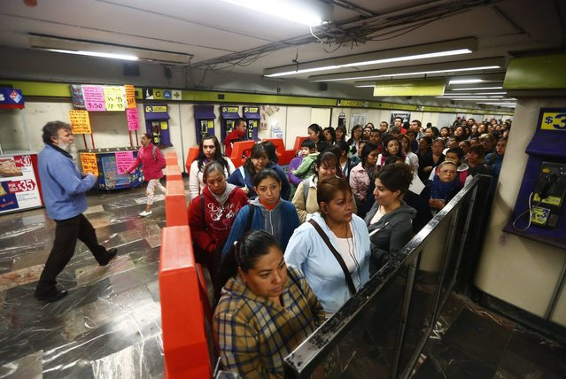 Women stand together inside a segregated area while waiting to board Women-Only passenger cars at a subway station in Mexico City October 23, 2014. (Photo by Edgard Garrido/Reuters)
