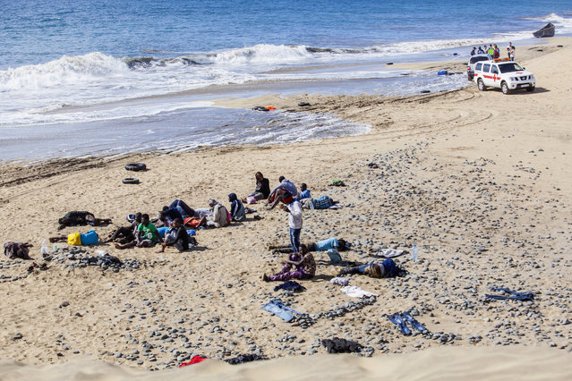 Would-be immigrants rest at Maspalomas beach on Gran Canaria, Spain's Canary Islands. (Photo by Borja Suarez/Reuters)