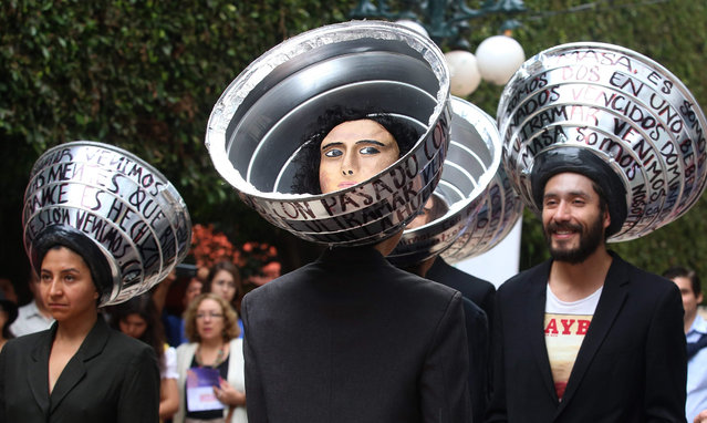A group of artists perform the play 'LOStheULTRAMAR' in the street during the 43 International Festival Cervantino (FIC) in Guanajuato, Mexico, 09 October 2015. (Photo by Ulises Ruiz Basurto/EPA)