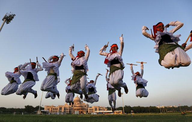 Folk dancers perform Dandiya, a traditional dance, during a rehearsal ahead of Navratri festival in Ahmedabad, India, October 11, 2015. Navratri, held in honour of Hindu Goddess Durga, is celebrated over a period of nine days where thousands of youths dance the night away in traditional costumes. Navratri starts on October 13 this year. (Photo by Amit Dave/Reuters)