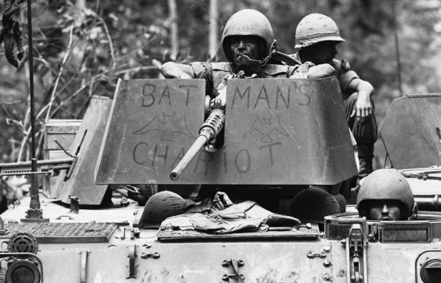 Comic strip and television hero Batman has joined the troops in Viet Nam, December 14, 1966. Here he rides an armored cavalry assault vehicle, a light tank that bristles with machine guns. (Photo by Horst Faas/AP Photo)