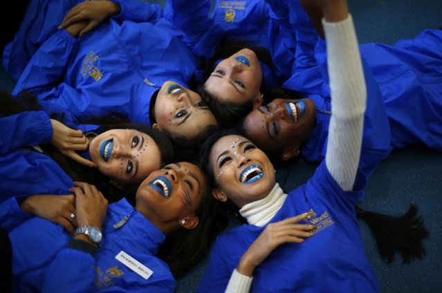 Miss Thailand Maya Nonthawan Thongleng takes a selfie with other contestants during the Miss World sports competition at the Lee Valley sports complex in north London, November 26, 2014. (Photo by Andrew Winning/Reuters)