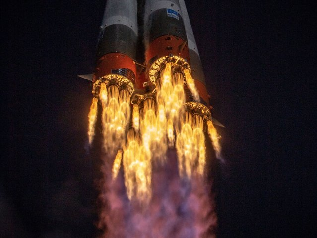 The Soyuz MS-17 spacecraft carrying the International Space Station (ISS) expedition 64 crew of NASA astronaut Kate Rubins and Russian cosmonauts Sergey Ryzhikov and Sergey Kud-Sverchkov blasts off to the ISS from the Russian-leased Baikonur cosmodrome in Kazakhstan on October 14, 2020. (Photo by Roscosmos/Handout via AFP Photo)