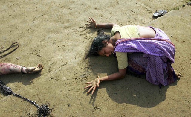 An Indian woman mourns the death of her relative who was killed in a tsunami in Cuddalore, south of the southern Indian city of Madras, in this December 28, 2004 file photo. On December 26, 2004, a magnitude 9.15 quake off the coast of Indonesia's Aceh province triggered an Indian Ocean tsunami that killed around 226,000 people in Indonesia, Sri Lanka, India, Thailand and nine other countries. (Photo by Arko Datta/Reuters)