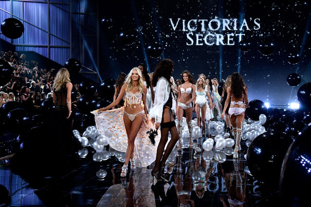 Victoria's Secret models walk the runway at the annual Victoria's Secret fashion show at Earls Court on December 2, 2014 in London, England. (Photo by Pascal Le Segretain/Getty Images)