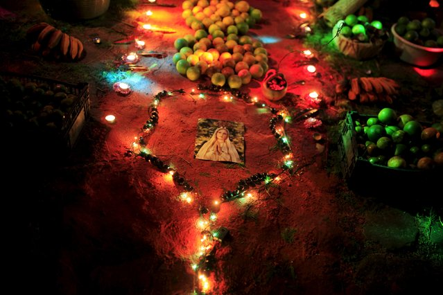 """An image of the Virgin Mary is set on a family altar during the celebration of """"Los Canchules"""" in Nahuizalco November 1, 2015. (Photo by Jose Cabezas/Reuters)"""