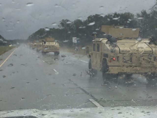 A convoy of Georgia National Guard Soldiers of the Monroe-based 178th Military Police Company, are moving through rain to assist first responders and citizens of Savannah, Georgia, U.S., October 8, 2016. (Photo by Courtesy Michael Perry/Reuters/U.S. Army National Guard)