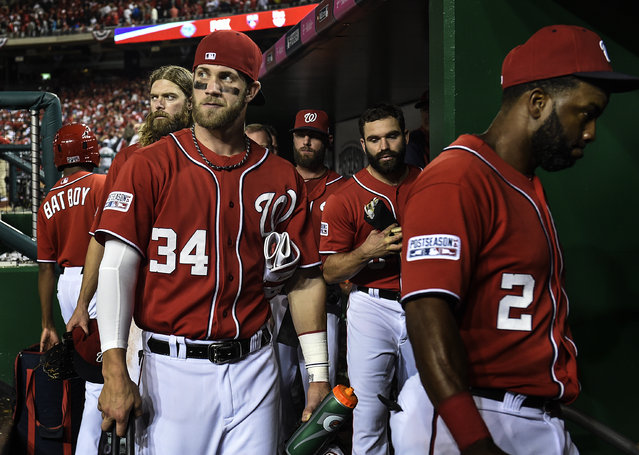 The Washington Nationals head back into the clubhouse after losing the first game of the National League Divisional Series between the Washington Nationals and the San Francisco Giants at Nationals Park on Tuesday, October 3, 2014. (Photo by Toni L. Sandys/The Washington Post)