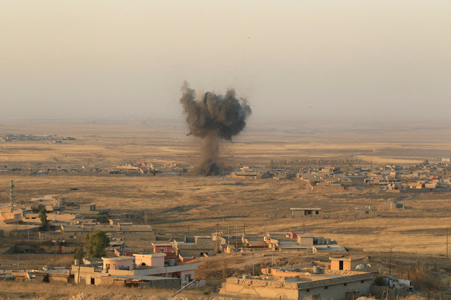 Smoke rises at Islamic State militants' positions in town of Naweran near Mosul, Iraq October 20, 2016. (Photo by Zohra Bensemra/Reuters)