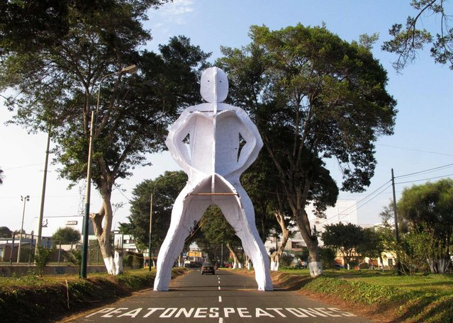 """A sculpture by artist Joaquin Liebana is seen on a street in Lima's Barranco district, May 7, 2013. The sculpture is part of the exhibition """"White Night"""". (Photo by Mariana Bazo/Reuters)"""