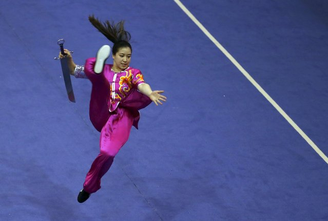 Australia's Elizabeth Lim competes in the women's nandao final during the 13th World Wushu Championship 2015 at Istora Senayan stadium in Jakarta, November 17, 2015. (Photo by Reuters/Beawiharta)