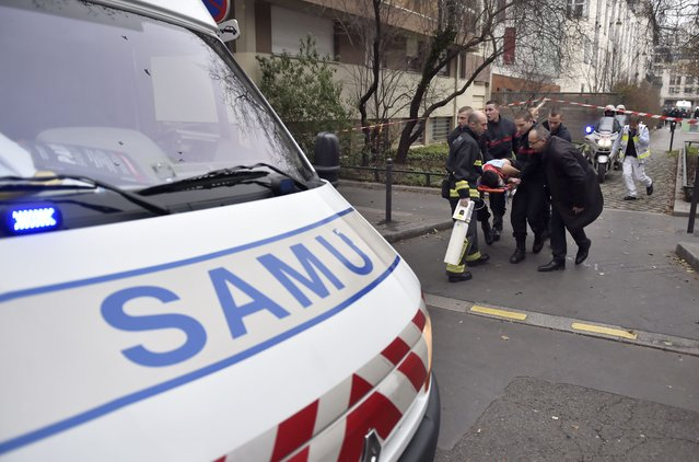 A victim is evacuated on a stretcher on January 7, 2015 after armed gunmen stormed the offices of the French satirical newspaper Charlie Hebdo in Paris. (Photo by Martin Bureau/AFP Photo)