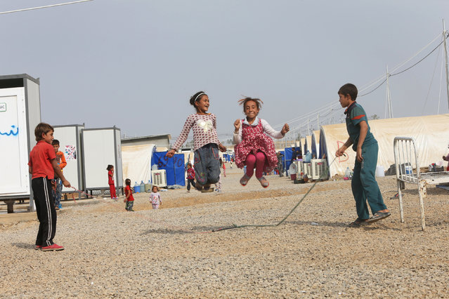 Displaced children who fled Islamic State militants from Mosul play at Debaga camp, on the outskirts of Erbil, Iraq on October 28, 2016. (Photo by Alaa Al-Marjani/Reuters)