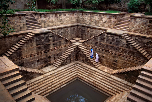 Stepwells have existed in India for hundreds of years, and helped to provide water storage during the dry seasons and offer people a place to socialise. This one was pictured in Rajasthan, 2002. (Photo by Steve McCurry)