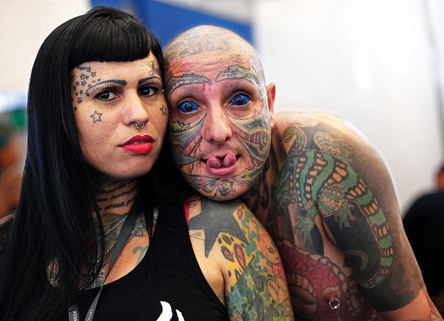 Totolinha, left, and Rato pose for a photo during Rio Tattoo Week in Rio de Janeiro, Brazil, Friday, January 16, 2015. Tattoo artists from Brazil and around the world gathered for the annual three day convention. (Photo by Silvia Izquierdo/AP Photo)